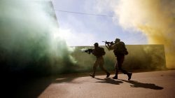 U.S. Marine and an Israeli soldier practice urban combat during Juniper Cobra, a U.S.-Israeli joint air defence exercise, in Zeelim, southern Israel, March 12, 2018. REUTERS/Amir Cohen