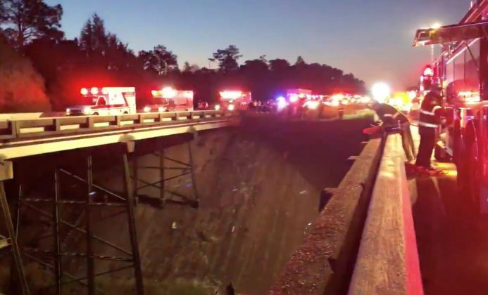 Emergency service vehicles gather on Interstate 10 at the scene of a bus crash in Baldwin County, Alabama, U.S., March 13, 2018 in this still image obtained from social media video. Jesus Tejeda via REUTERS