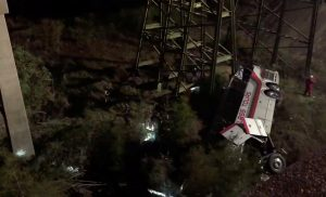 Rescue workers attend to the scene of a bus crash in Baldwin County, Alabama, U.S., March 13, 2018 in this still image obtained from social media video. Jesus Tejeda via REUTERS