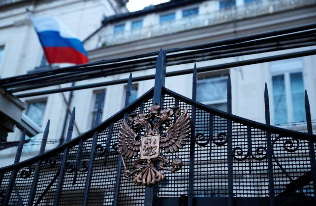 Russia's flag flies from the consular section of its embassy, in central London, Britain March 14, 2018. REUTERS/Phil Noble
