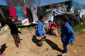Syrian refugee children play at a tented settlement in the town of Qab Elias, in Lebanon's Bekaa Valley, March 13, 2018. REUTERS/Mohamed Azakir