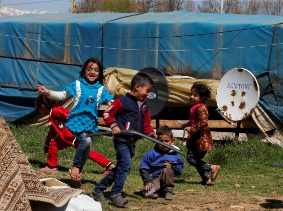 Syrian refugee children run in a tented settlement in the town of Qab Elias, in Lebanon's Bekaa Valley, March 13, 2018. REUTERS/Mohamed Azakir