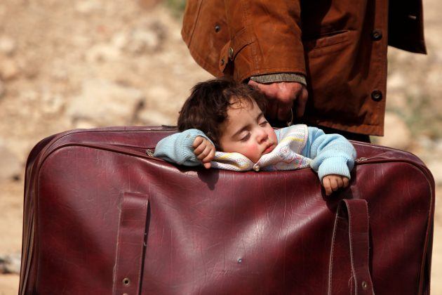 A child sleeps in a bag in the village of Beit Sawa, eastern Ghouta, Syria March 15, 2018. REUTERS/Omar Sanadiki