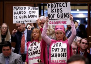 People supporting gun control attend a hearing by the Senate Judiciary Committee during a hearing about legislative proposals to improve school safety in the wake of the mass shooting at the high school in Parkland, Florida, on Capitol Hill in Washington, U.S., March 14, 2018. REUTERS/Joshua Roberts