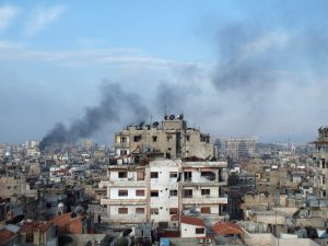 FILE PHOTO: Smoke rises from one of the buildings in the city of Homs, Syria March 11, 2013. REUTERS/Yazan Homsy/File Photo