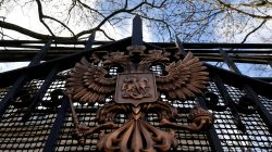 A coat of arms is seen on a gate outside of the Russian embassy in London, Britain, March 16, 2018. REUTERS/Toby Melv