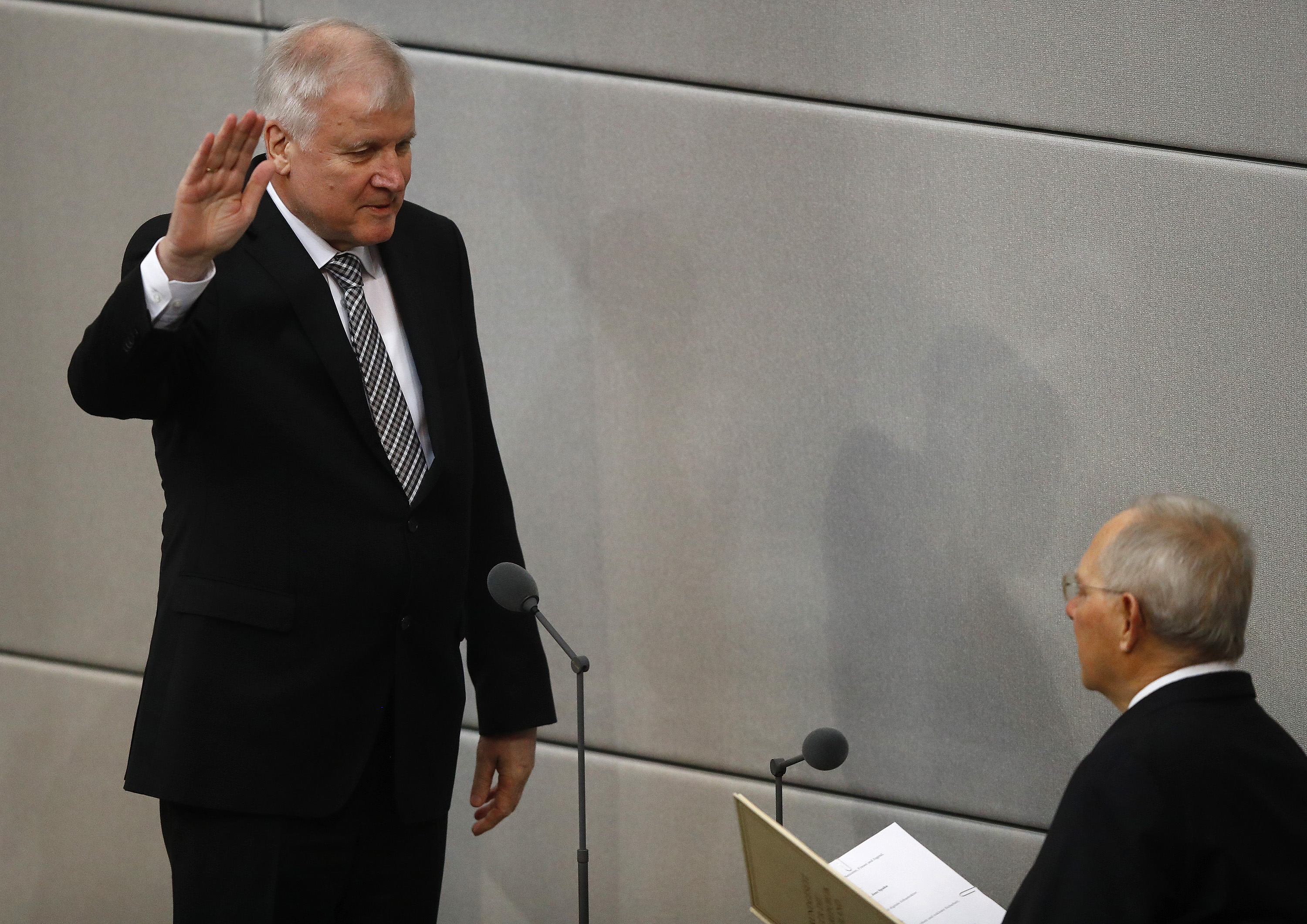 German Interior Minister Horst Seehofer is sworn-in by Parliament President Wolfgang Schaeuble in Germany's lower house of parliament Bundestag in Berlin, Germany, March 14, 2018. REUTERS/Kai Pfaffenbach