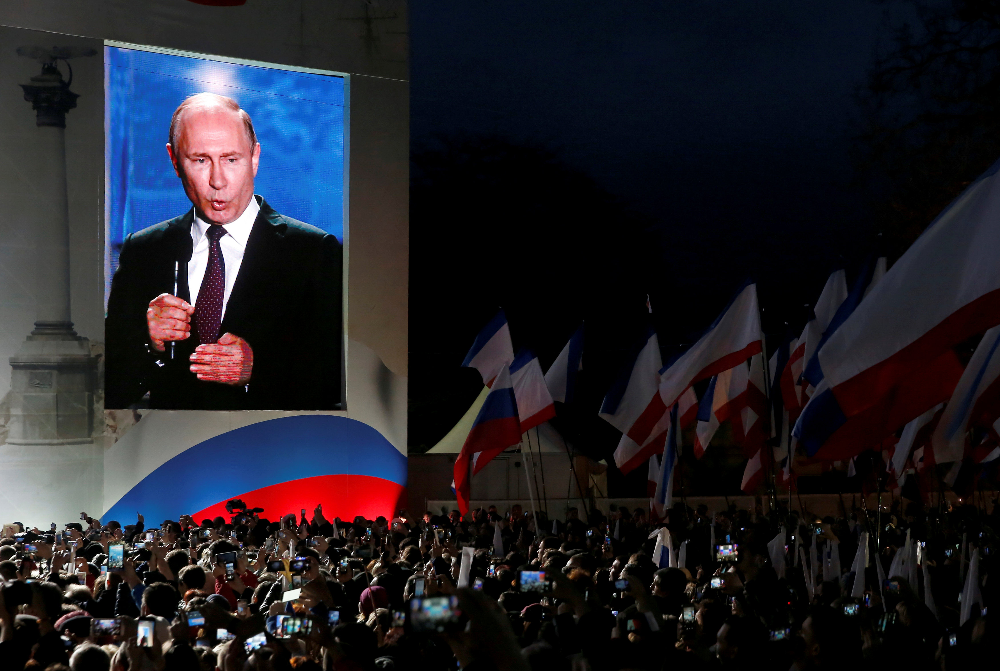 FILE PHOTO: Russian President Vladimir Putin addresses the audience during a rally marking the fourth anniversary of Russia's annexation of Ukraine's Crimea region in the Black Sea port of Sevastopol, Crimea, March 14, 2018. REUTERS/Maxim Shemetov/File Photo