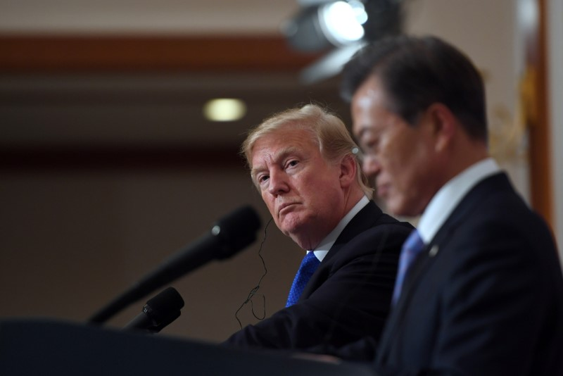 FILE PHOTO: U.S. President Donald Trump and South Korea's President Moon Jae-in hold a joint press conference at the presidential Blue House in Seoul, South Korea, November 7, 2017. REUTERS/Jung Yeon-Je/Pool