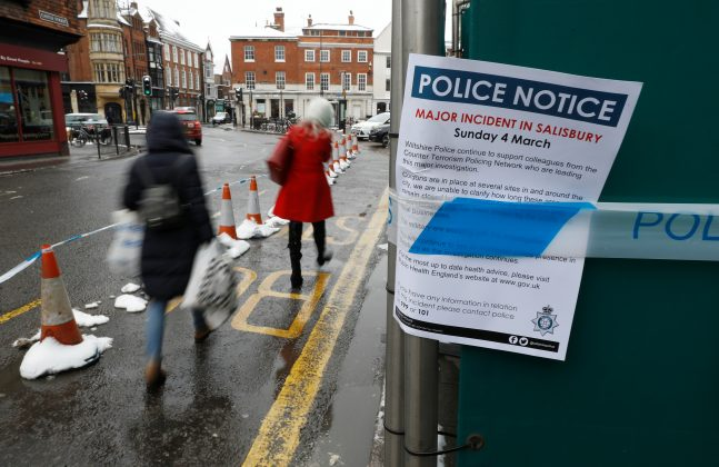 A police notice is attached to screening surrounding a restaurant which was visited by former Russian intelligence officer Sergei Skripal and his daughter Yulia before they were found on a park bench after being poisoned in Salisbury, Britain, March 19, 2018. REUTERS/Peter Nichol