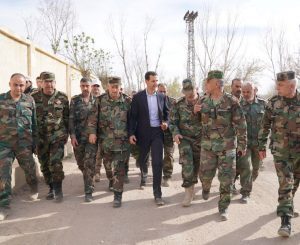 Syrian President Bashar al-Assad walks with Syrian army soldiers in eastern Ghouta, Syria, March 18, 2018. SANA/Handout via REUTERS