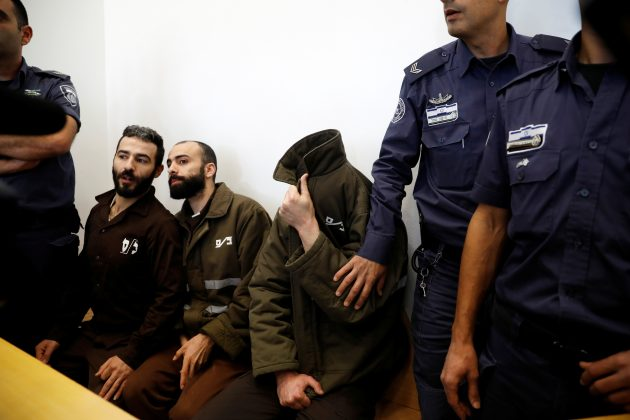 Romain Franck, an employee of the French consulate-general in Jerusalem, appears with co-defendants in the district court in Beersheba, Israel, March 19, 2018. REUTERS/Amir Cohen