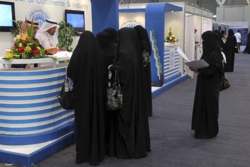 FILE PHOTO: Saudi Arabian women, seeking a job, talk with recruiters during a job fair in Riyadh January 25, 2012. REUTERS/ Stringer