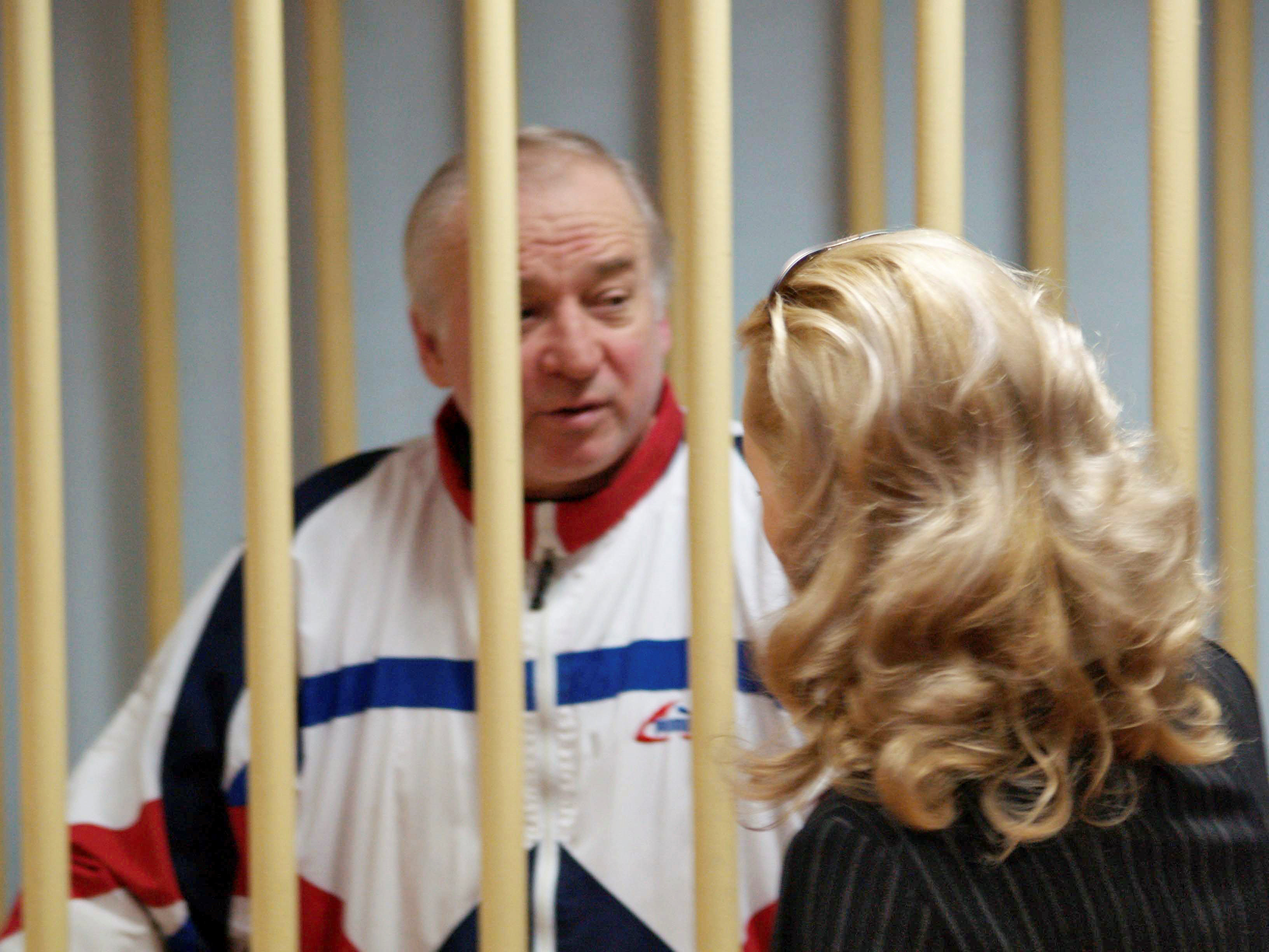 ILE PHOTO: Sergei Skripal, a former colonel of Russia's GRU military intelligence service, looks on inside the defendants' cage as he attends a hearing at the Moscow military district court, Russia August 9, 2006. Kommersant/Yuri Sen