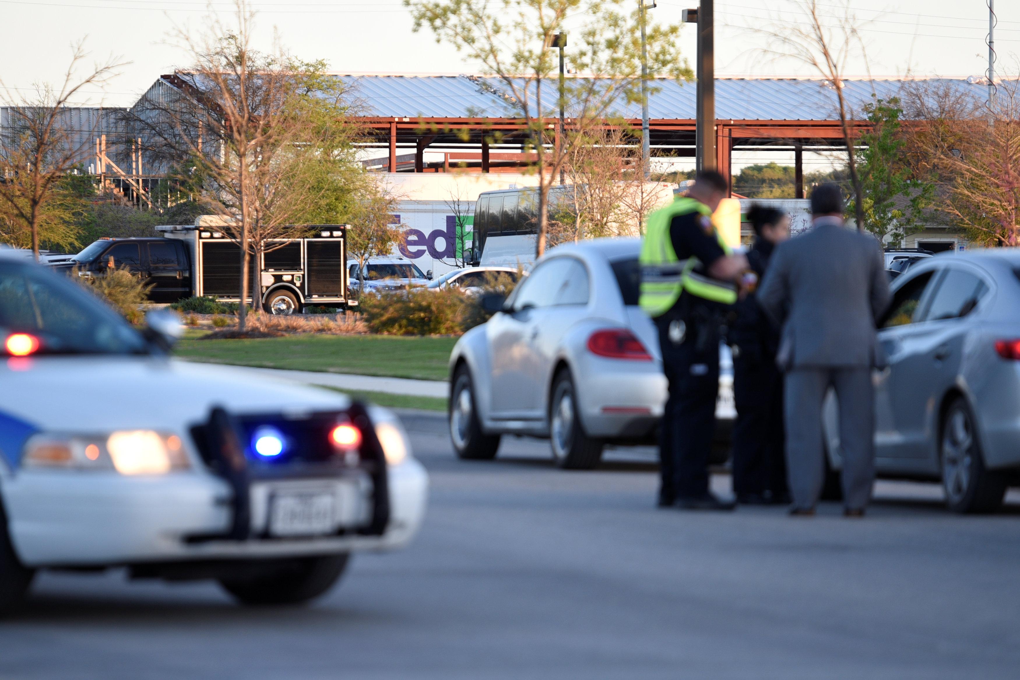 Schertz Police block off Doerr Lane near the scene of a blast at a FedEx facility in Schertz, Texas, U.S., March 20, 2018. REUTERS/Sergio Flore