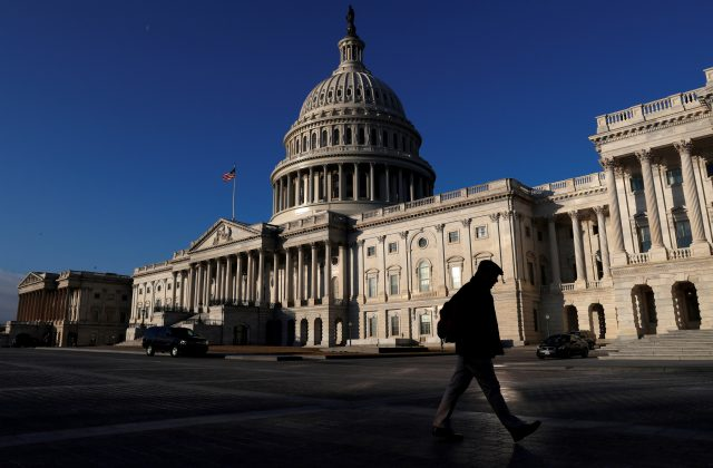 People walk by the U.S. Capitol building in Washington, U.S., February 8, 2018. REUTERS/Leah Millis/File Photo