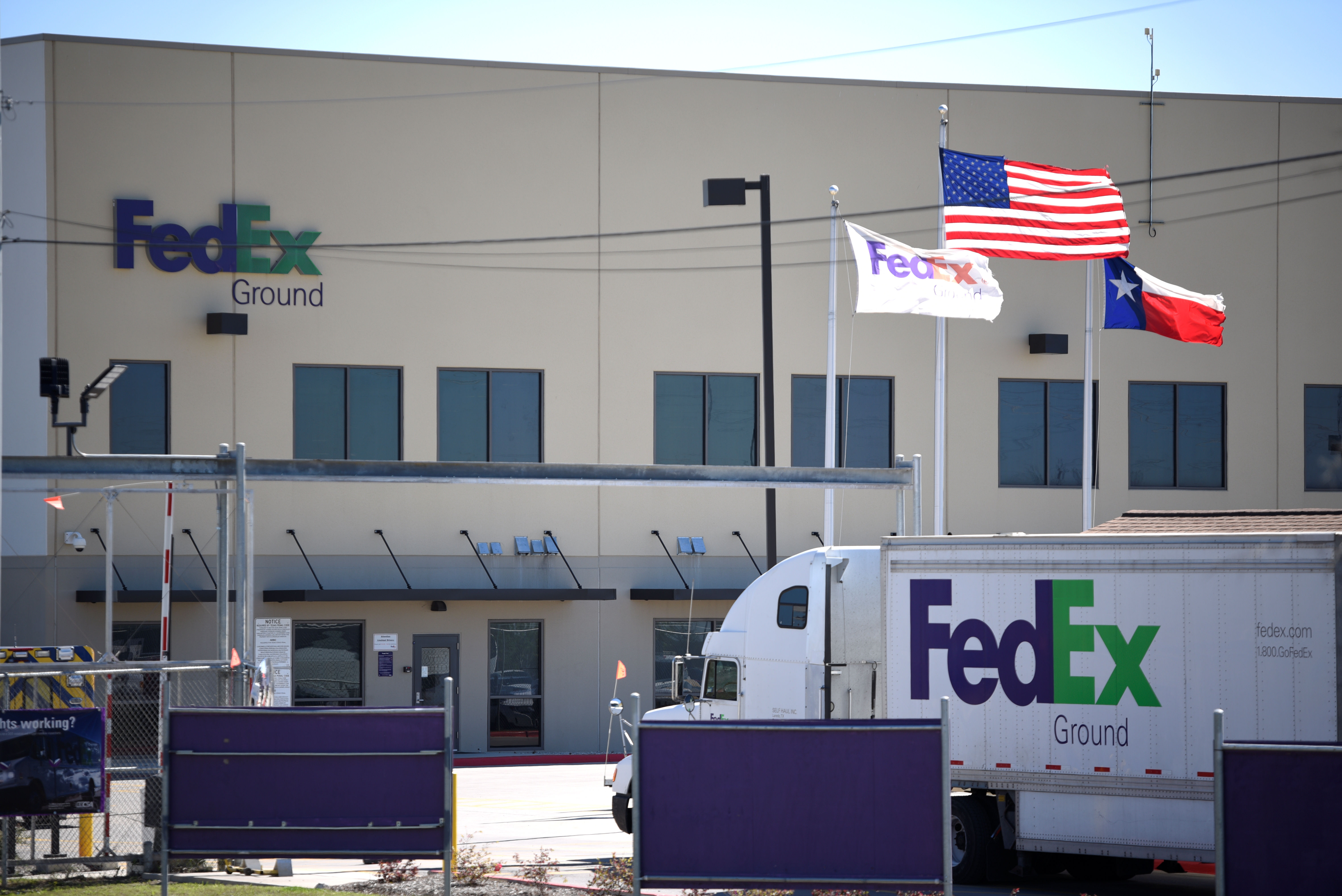 A FedEx truck is seen outside FedEx facility following the blast, in Schertz, Texas, U.S., March 20, 2018. REUTERS/Sergio Flores