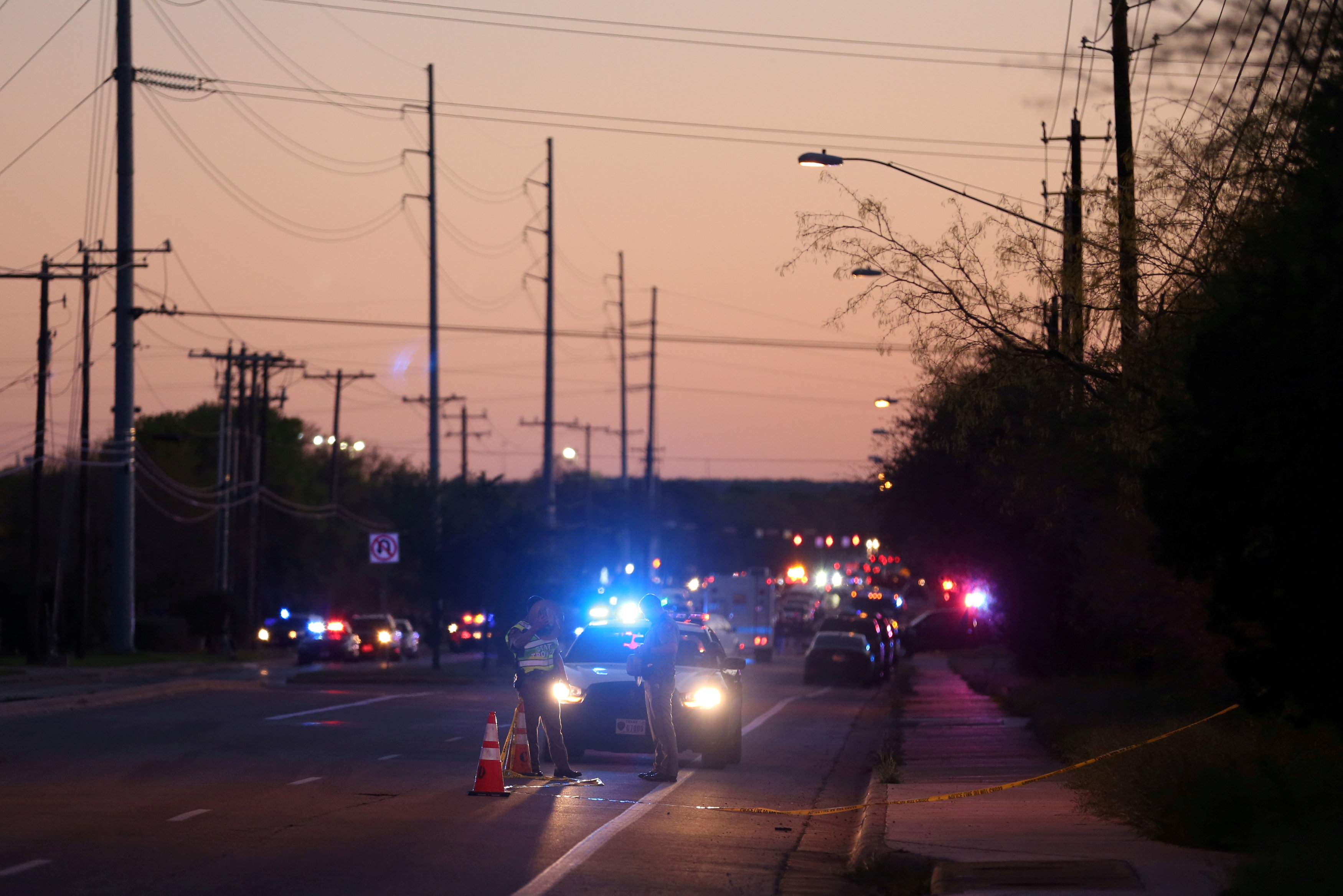 FILE PHOTO: Law enforcement personnel investigate an incident that they said involved an incendiary device in the 9800 block of Brodie Lane in Austin, Texas, U.S., March 20, 2018.REUTERS/Loren Elliott