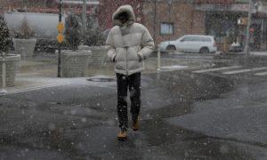 A pedestrian walks through a late season snow storm in New York, U.S., March 21, 2018. REUTERS/Lucas Jackson