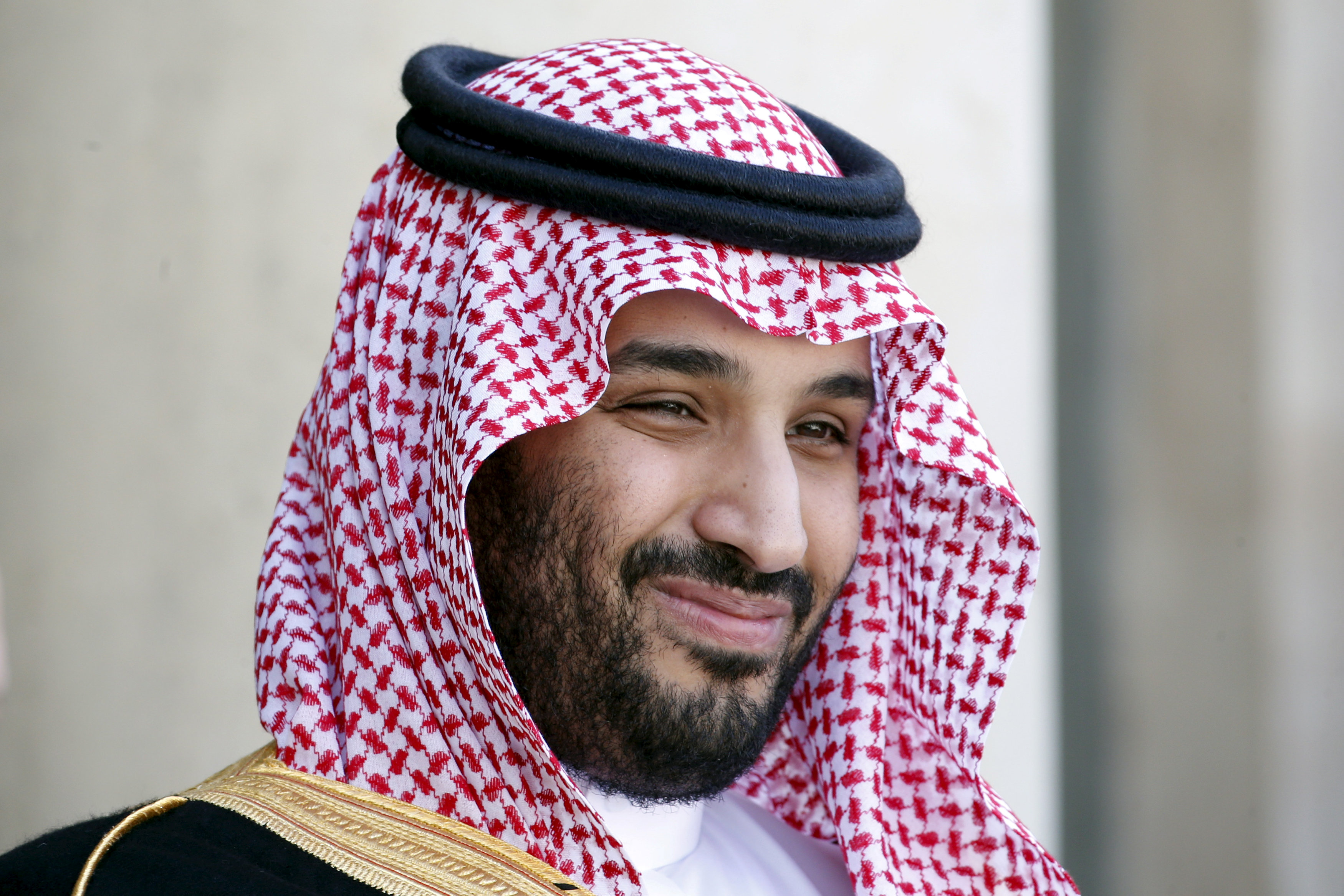 FILE PHOTO: Saudi Arabia's then Deputy Crown Prince Mohammed bin Salman reacts upon his arrival at the Elysee Palace in Paris, France, June 24, 2015. REUTERS/Charles Platiau/File Photo