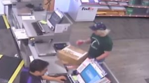 A surveillance image shows the serial bombing suspect inside a FedEx office store in Austin, Texas, U.S., which was given to law enforcement and obtained by TV station, WOAI/KABB, March 21, 2018. Courtesy of WOAI/KABB/Handout via Reuters