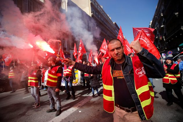 Protestors light flares as they attend a demonstration during a national day of strike against reforms in Marseille, France, March 22, 2018. REUTERS/Jean-Paul Pelissier