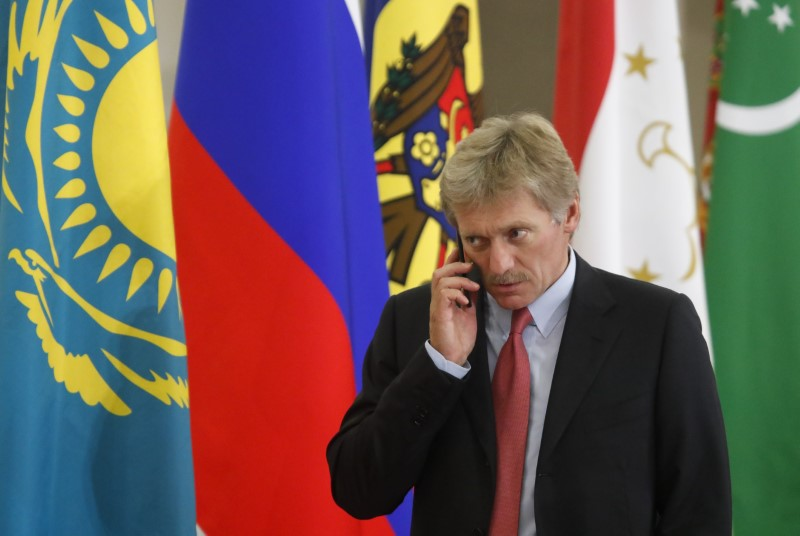 FILE PHOTO - Kremlin spokesman Dmitry Peskov speaks on the phone before a session of the Council of Heads of the Commonwealth of Independent States (CIS) in Sochi, Russia October 11, 2017.