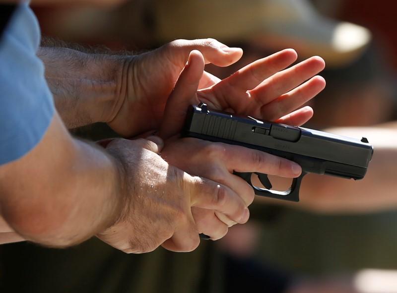 Instructors work with participants on proper gun handling during a firearms training class at the PMAA Gun Range in Salt Lake City, Utah, July 1, 2016. REUTERS/Jim Urquhar