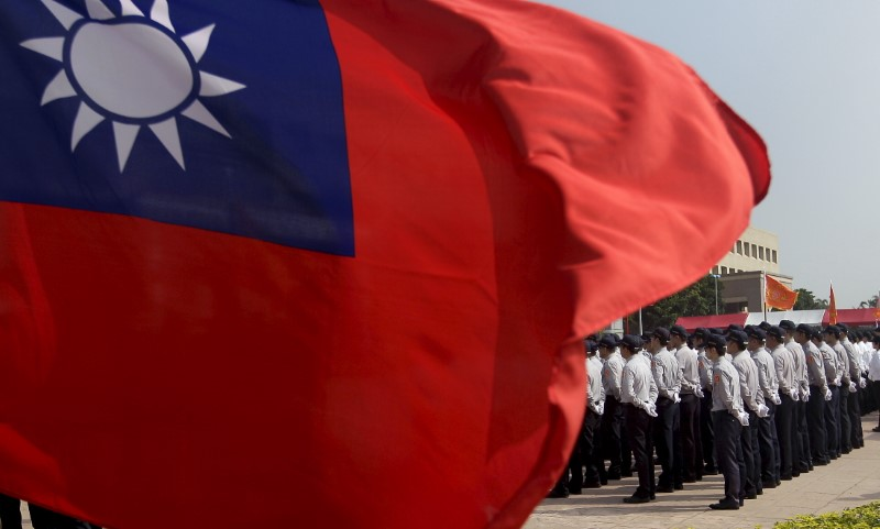FILE PHOTO: Members of the National Security Bureau take part in a drill next to a national flag at its headquarters in Taipei, Taiwan, November 13, 2015. REUTERS/Pichi C
