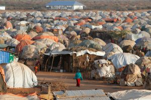 A woman walks past thw makeshift shelters at the new Kabasa Internally displaced camp in the northern Somali town of Dollow, Somalia, February 25, 2018. Picture taken February 25, 2018. REUTERS/Baz Ratner
