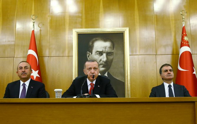 Turkish President Tayyip Erdogan, accompanied by Foreign Minister Mevlut Cavusoglu and Minister of European Union Affairs Omer Celik, speaks during a news conference at Ataturk International airport in Istanbul, Turkey March 26, 2018. Kayhan Ozer/Presidential Palace/Handout via REUTERS ATTENTION EDITORS - THIS PICTURE WAS PROVIDED BY A THIRD PARTY. NO RESALES. NO ARCHIVE.