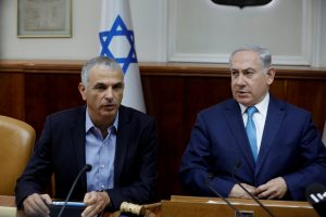 FILE PHOTO: Israeli Prime Minister Benjamin Netanyahu (R) and Israeli Finance Minister Moshe Kahlon attend the weekly cabinet meeting at the Prime Minister's office in Jerusalem December 24, 2017. REUTERS/Amir Cohen/File Photo