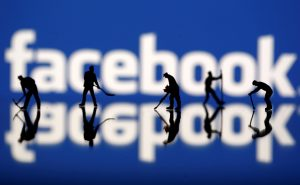 Figurines are seen in front of the Facebook logo in this illustration taken March 20, 2018. REUTERS/Dado Ruvi