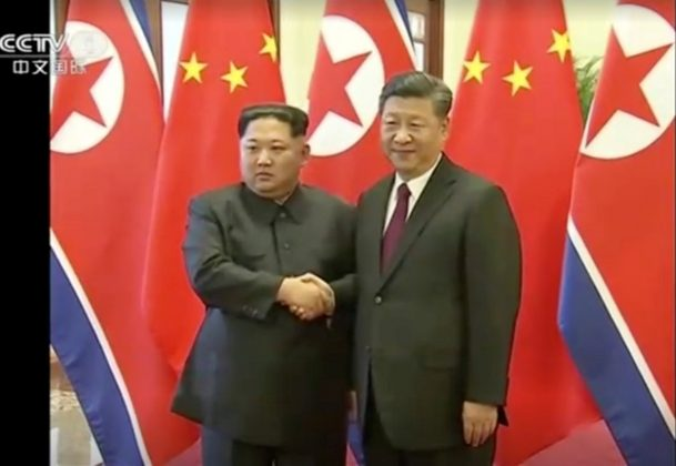 North Korean leader Kim Jong Un shakes hands with Chinese President Xi Jinping, in this still image taken from video released on March 28, 2018. North Korean leader Kim Jong Un visited China from Sunday to Wednesday on an unofficial visit, China's state news agency Xinhua reported on Wednesday. CCTV via Reuters TV
