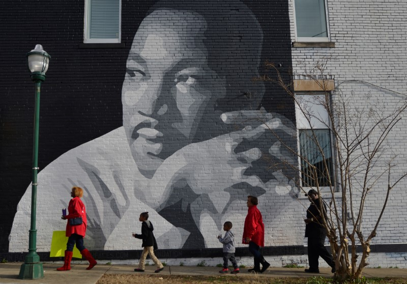 FILE PHOTO: People gather to march in the annual parade down MLK Boulevard to honor Martin Luther King, in Chattanooga, Tennessee, U.S., January 16, 2017. REUTERS/Billy Weeks