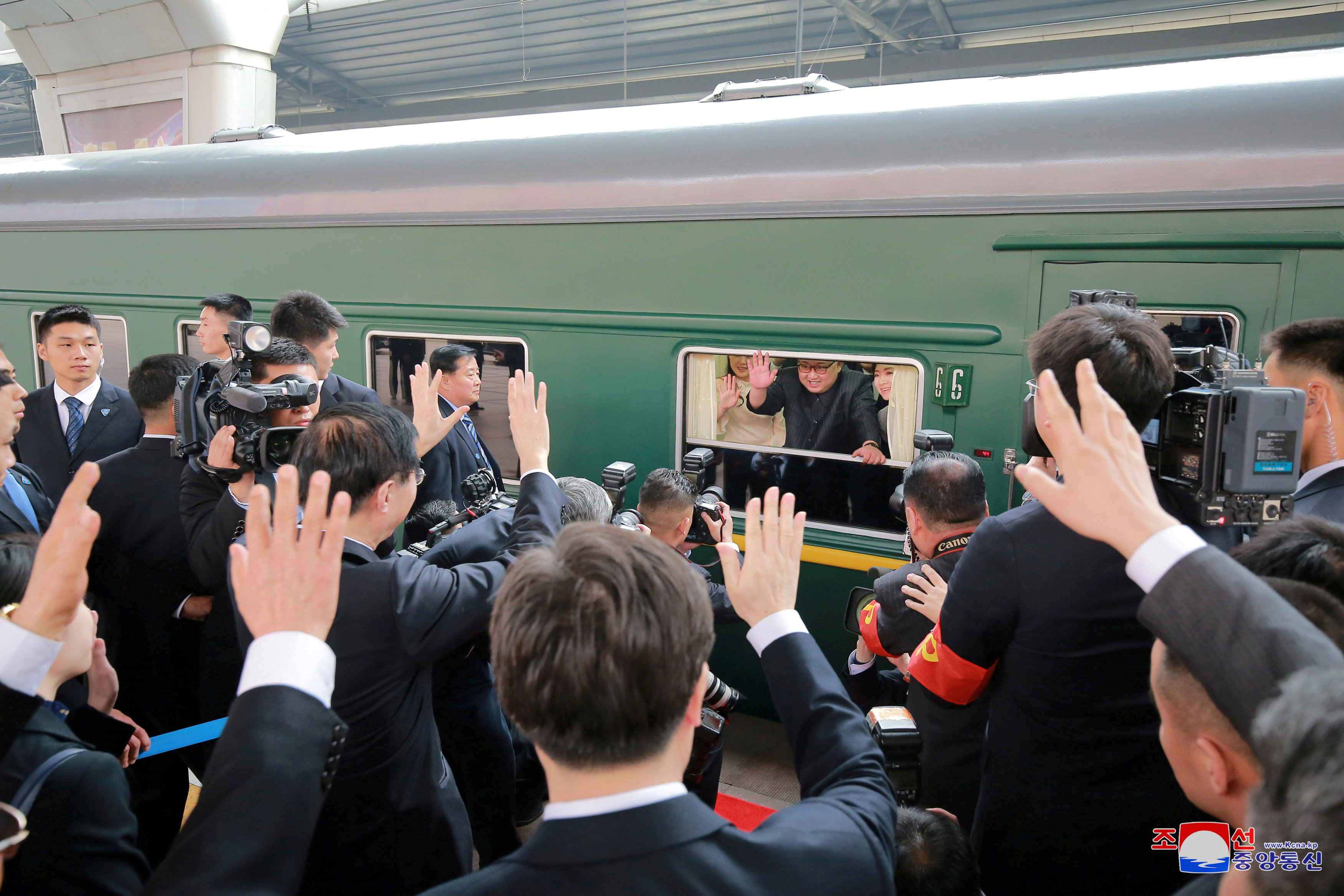 FILE PHOTO: North Korean leader Kim Jong Un waves from a train, as he paid an unofficial visit to China, in this undated photo released by North Korea's Korean Central News Agency (KCNA) in Pyongyang March 28, 2018. KCNA/via Reuters/File Photo
