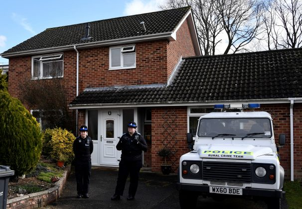 Police officers stand guard outside of the home of former Russian military intelligence officer Sergei Skripal, in Salisbury, Britain, March 6, 2018. REUTERS/Toby Melville