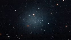 The galaxy named NGC 1052-DF2, a large fuzzy-looking galaxy so diffused that astronomers call it a 'see-through' galaxy because its missing most, if not all of its dark matter, is shown in this photo obtained from NASA on March 28, 2018. NASA, ESA, and P. van Dokkum (Yale University)/Handout via REUTERS