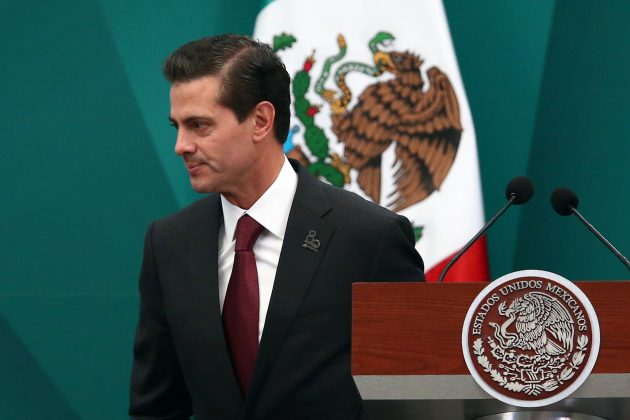 FILE PHOTO: Mexico's President Enrique Pena Nieto is pictured during the 80th anniversary of the expropriation of Mexico's oil industry in Mexico City, Mexico March 16, 2018. REUTERS/Edgard Garrido
