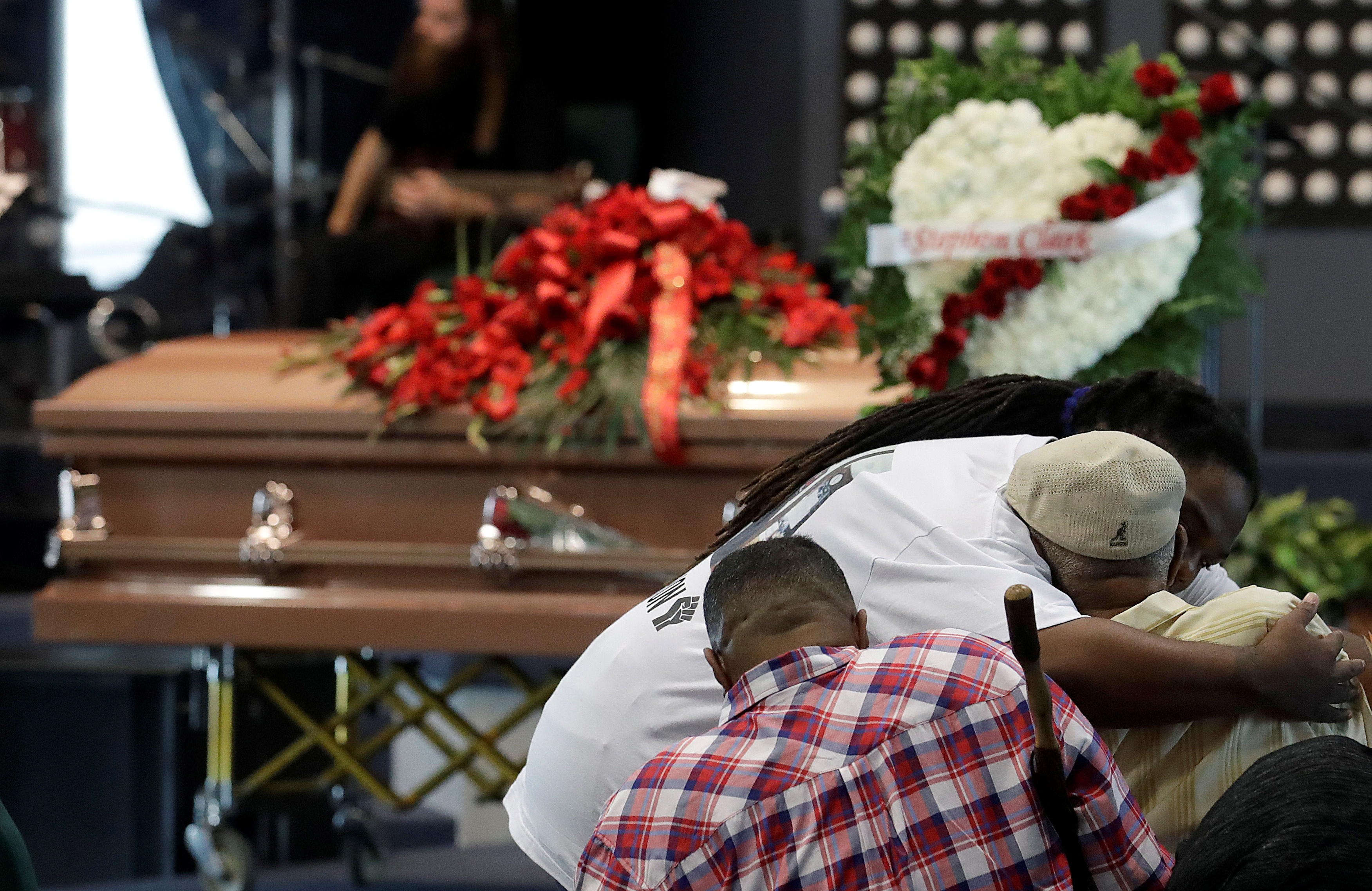 Mourners embrace before the funeral services for police shooting victim, Stephon Clark at Bayside Of South Sacramento Church, in Sacramento, California, March 29, 2018. Jeff Chiu/Pool via Reuters