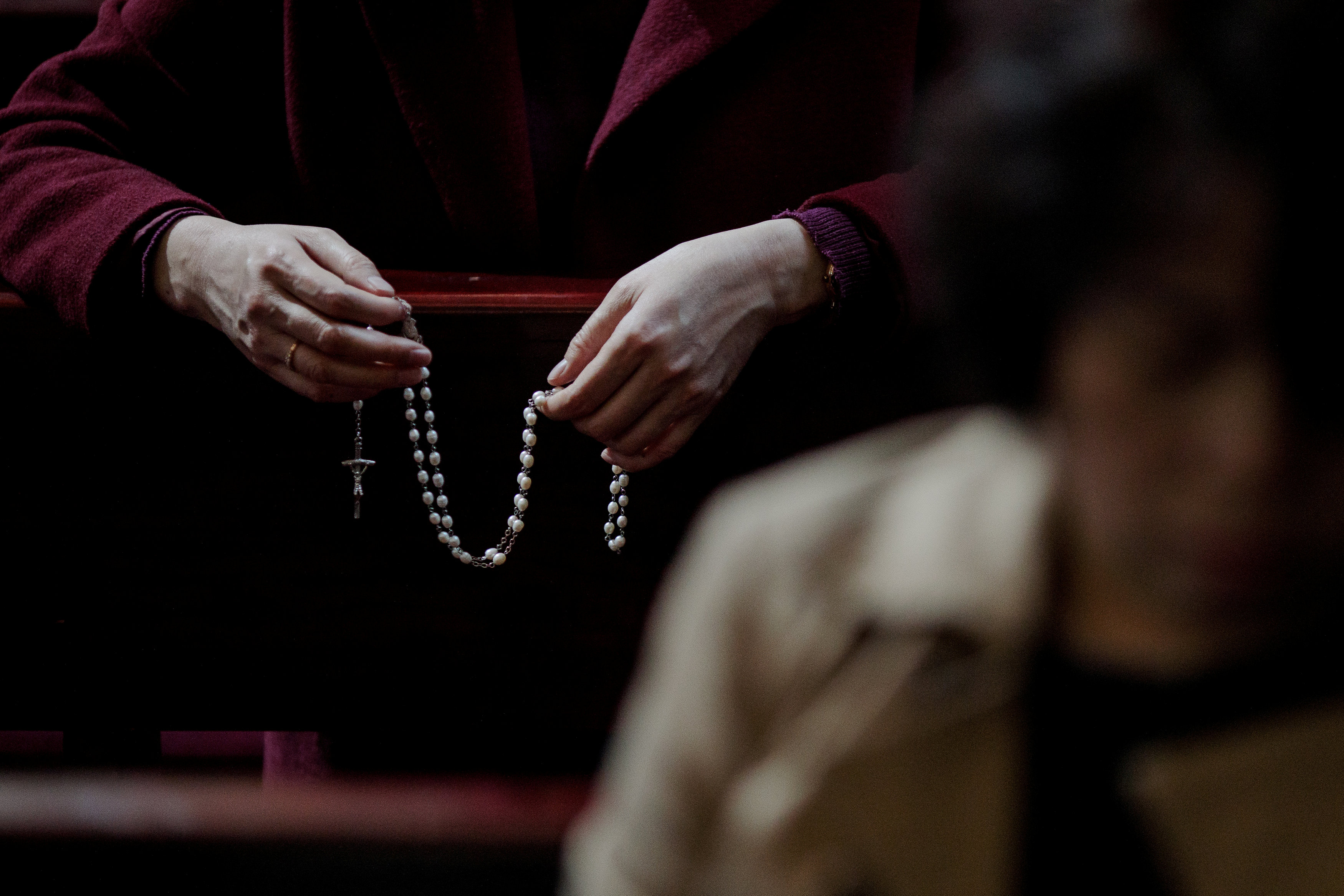 FILE PHOTO: A Catholic faithful holds a rosary during a mass on Holy Thursday at the Cathedral of the Immaculate Conception in Beijing, China March 29, 2018. REUTERS/Damir Sagolj/File Photo
