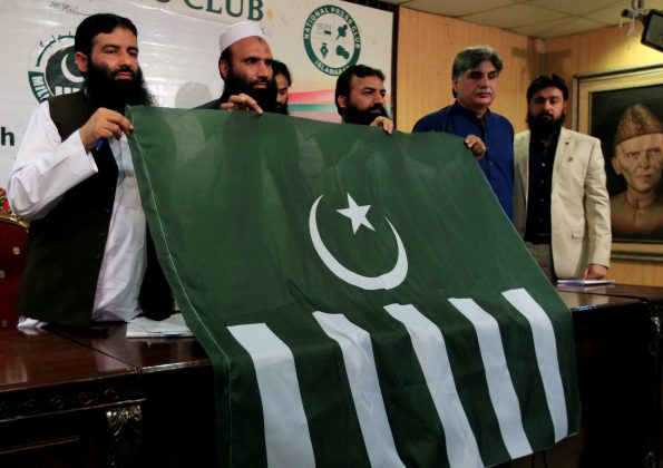 FILE PHOTO:Saifullah Khalid (2nd L), President of Milli Muslim League (MML) political party, holds a party flag with others during a news conference in Islamabad, Pakistan August 7, 2017. REUTERS/Faisal Mahmood/File Photo