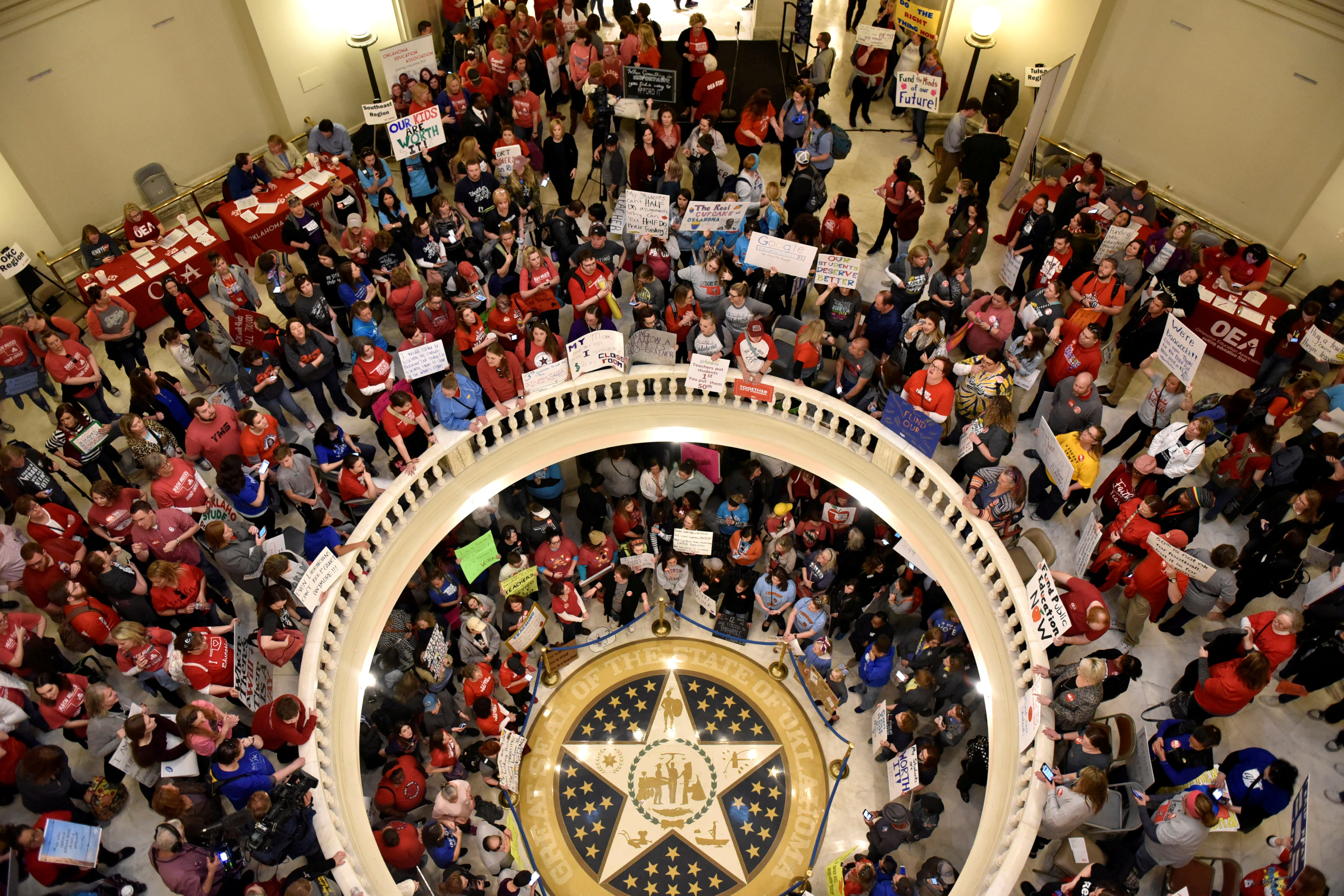 FILE PHOTO - Teachers pack the state Capitol rotunda to capacity, on the second day of a teacher walkout, to demand higher pay and more funding for education, in Oklahoma City, Oklahoma, U.S., April 3, 2018. REUTERS/Nick Oxford