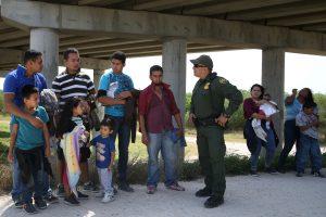 Border patrol agent Sergio Ramirez talks with immigrants who illegally crossed the border from Mexico into the U.S. in the Rio Grande Valley sector, near McAllen, Texas, U.S., April 2, 2018. REUTERS/Loren Elliott
