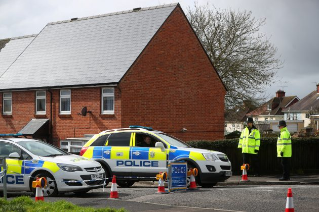 Police officers guard the cordoned off area around the home of former Russian intelligence officer Sergei Skripal in Salisbury, Britain, April 3, 2018. REUTERS/Hannah McKay