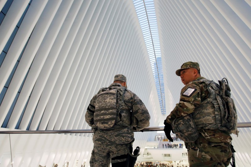 FILE PHOTO - Members of the U.S Army National Guard monitor the Oculus transportation hub ahead of the U.S presidential election in Manhattan, New York, U.S., November 7, 2016. REUTERS/Andrew Kelly
