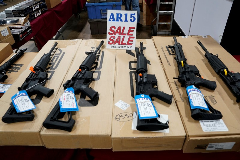 FILE PHOTO - AR-15 rifles are displayed for sale at the Guntoberfest gun show in Oaks, Pennsylvania, U.S., October 6, 2017. REUTERS/Joshua Roberts