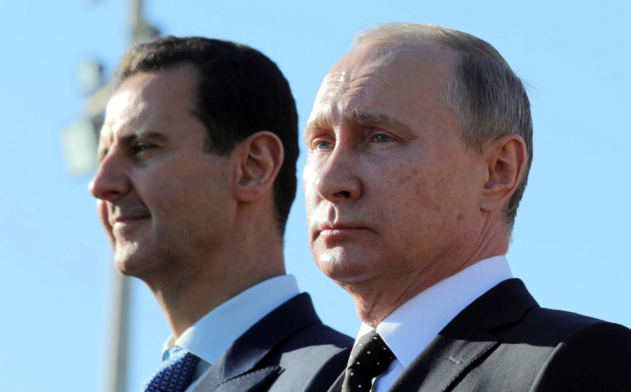 Russian President Vladimir Putin (R) and Syrian President Bashar al-Assad visit the Hmeymim air base in Latakia Province, Syria December 11, 2017. Picture taken December 11, 2017. To match Special Report RUSSIA-FLIGHTS/ Sputnik/Mikhail Klimentyev/ via REUTERS/File Photo