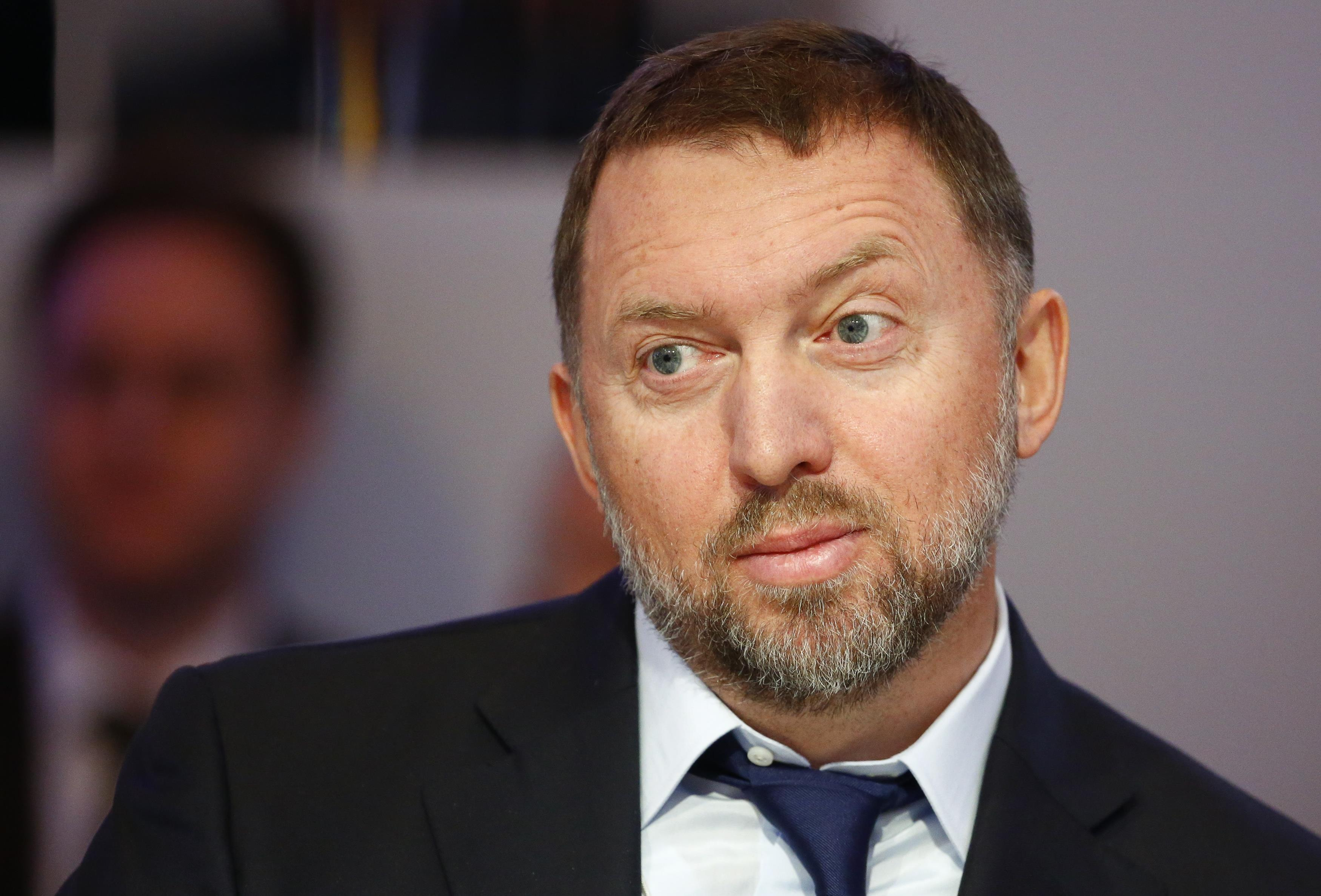 "FILE PHOTO: Russian tycoon and President of RUSAL Oleg Deripaska listens during the ""Regions in Transformation: Eurasia"" event in Davos, Switzerland January 22, 2015. REUTERS/Ruben Sprich/File Photo"