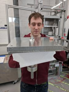 Alastair Wayman, Advanced Projects Engineer at Airbus Space, examines the tip of a large harpoon after a test firing into a simulated section of satellite as part of an European Space Agency project in Stevenage, Britain, April 4, 2018. Picture taken April 4, 2018. REUTERS/Stuart McDill